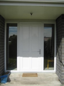 4 Solid aluminium entrance door with x 2 sidelites. Colour - White