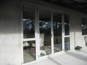 Full length glass french doors with sidelights. Colour-Silver Pearl