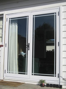 french doors with full lenght glass and french colonial squares. Colour-White